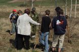 V.Klegere and pupils plant the trees