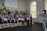 Sveiciens konferences dalībniekiem no Daugavpils Vienības pamatskolas lieliskā kora