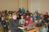 Evija Henina leads the project week`s introductory lecture about climate change in the world