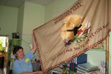 Iveta Steinberga shows renewed flag of the school